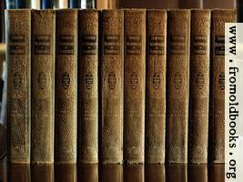 Green and Gold books on polished wood